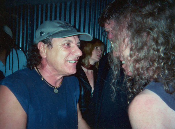 Brian Johnson with Waddy Wachtel backstage after performing with the band in 2004